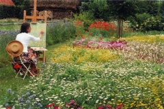 Malerin im Blumengarten
